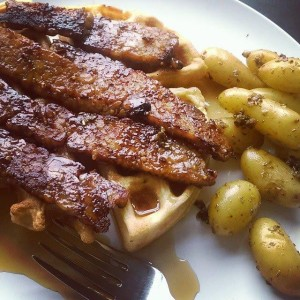 waffles smothered in tempeh bacon with garlic rosemary potatoes vegan
